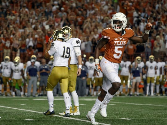 Texas Longhorns defensive back Holton Hill (5) reacts
