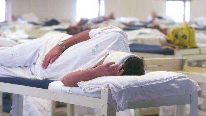 Some inmates have to cover their eyes to be able to nap during daylight hours at Staton Correctional Facility in this file photo. An inmate at the facility has tested positive for TB.