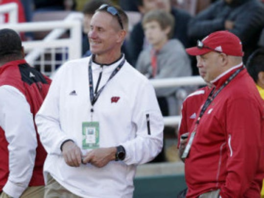 Wisconsin football coach Gary Andersen (center) leads a team that should compete for its third berth in four seasons in the Big Ten Championship Game. (AP)