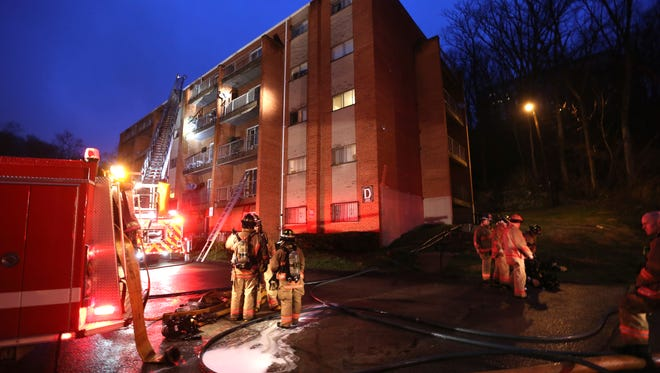 Crews at the scene of a 4-alarm fire at a Madisonville apartment building Thursday morning. The fire was quickly contained but two firefighters were injured. One suffered grave injuries after he fell down an elevator shaft.