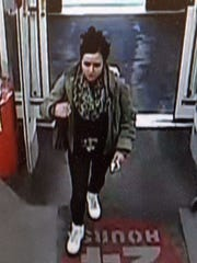 The female suspect has been identified and charged, but has not been located.