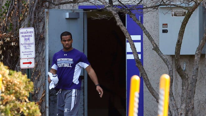 Northwestern University football player Ibraheim Campbell leaves the building where voting is taking place to determine if athletes want to form at union in Evanston, Illinois, April 25, 2014. Players on scholarship at the school are deciding whether they want the College Athletes Players Association (CAPA) to negotiate with Northwestern on their behalf. REUTERS/Jim Young (UNITED STATES - Tags: SPORT FOOTBALL)