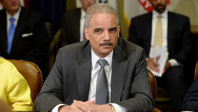 U.S. Attorney General Eric Holder attends a meeting with the My Brother's Keeper Task Force to receive a 90-day report on its progress in the Roosevelt Room of the White House May 30, 2014 in Washington, DC.