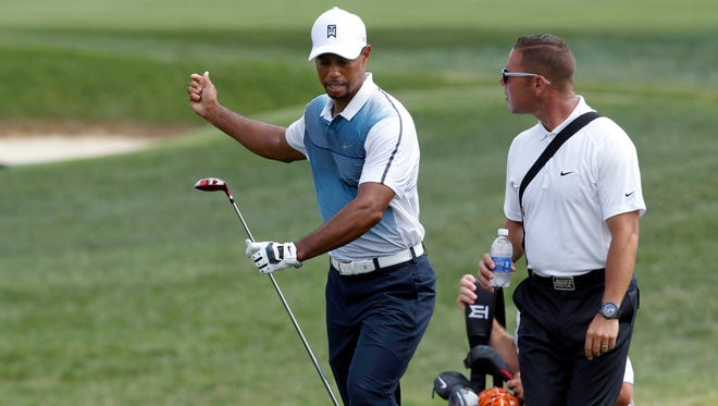 Tiger Woods talks with his swing coach, Sean Foley, after a shot on the seventh hole Wednesday during a practice round for the PGA Championship at Valhalla Golf Club.
