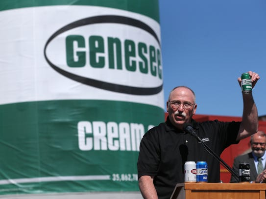 Genesee Brewery brewmaster Mike Mueller raises a toast