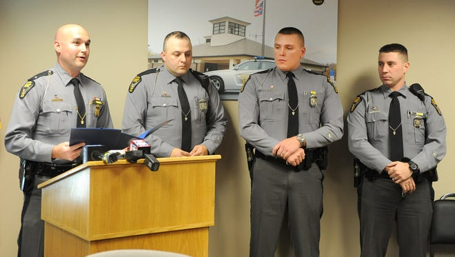 Mansfield post Commander Lt. Matt Them discusses the situations in which three Ohio Highway Patrol troopers, Matthew Stoffer, Drew Nelson and Steve Gillum, went above and beyond the call of duty. They were honored during a ceremony Wednesday afternoon.