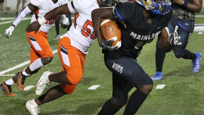 Mainland's TJ Lockley (11) verbally committed to Illinois on Friday, where he will have a shot in the secondary and in the receiving corps.
