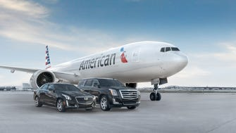 Cadillac vehicles are shown with an American Airlines aircraft in a photo provided by Cadillac and American.