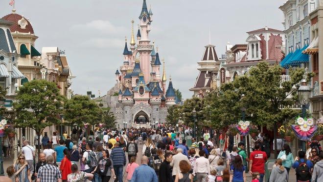 Visitors walk near Sleeping Beauty's Castle at Disneyland Paris in 2015.