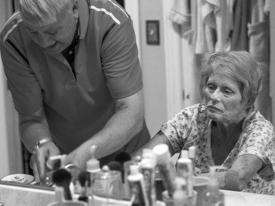 Fred helps Patty wash her hands in their master bathroom after lunch. Most of Patty's daily care is provided by Fred as the two spend their last days together in their Newburgh home.