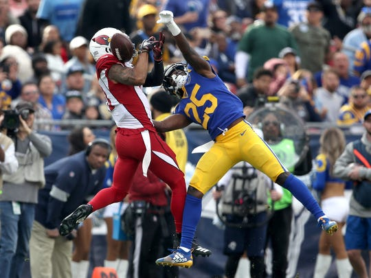 LOS ANGELES, CALIFORNIA - DECEMBER 29:  David Long #25 of the Los Angeles Rams breaks up a pass play intended for Christian Kirk #13 of the Arizona Cardinals during the first half of a game at Los Angeles Memorial Coliseum on December 29, 2019 in Los Angeles, California. (Photo by Sean M. Haffey/Getty Images)