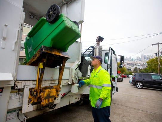 Recology Waste Zero employee Arnoldo Picazo collects