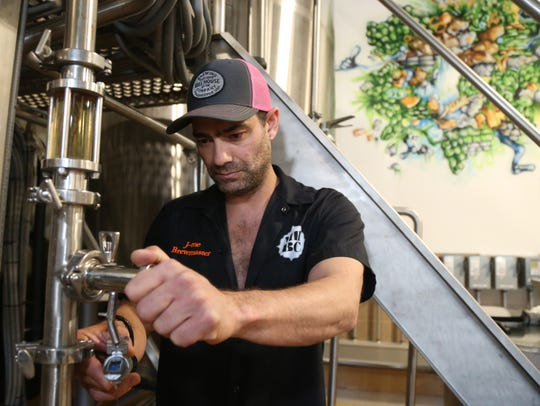 Mill House Brewing's brewmaster, Jamie Bishop checks