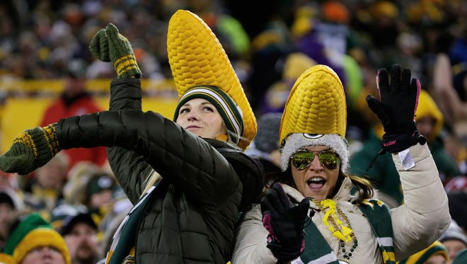 A pair of fans dance in the second half of the Packers-Vikings game.