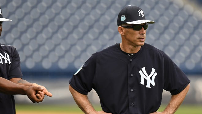 Joe Girardi says  baseball could operate the same way as NFL assistant coaches in the press box do.