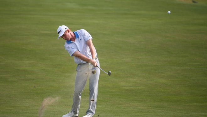 Jun 12, 2017: Amateur golfer Mason Andersen hits his fairway shot from the first hole during his practice round of the U.S. Open golf tournament at Erin Hills.