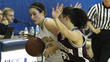 Walter Panas' Kellie Brown is pressured on the sideline by Harrison's Gina Nuvoloni during their Section 1 Class A girls basketball quarterfinal at Panas Feb. 23, 2017. Panas won 71-65.