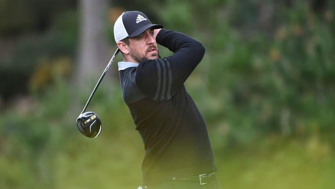 Aaron Rodgers watches his tee shot at the fourth tee during the first round of the 2017 AT&T Pebble Beach Pro-Am golf tournament at Monterey Peninsula Country Club.