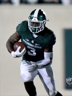 LJ Scott ran for 194 yards and  a pair of touchdowns in Michigan State's 30-27 victory over Minnesota.