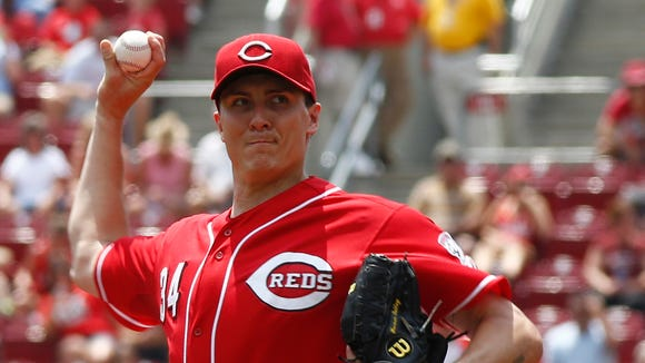 Cincinnati Reds starting pitcher Homer Bailey throws against the Chicago Cubs during the first inning.