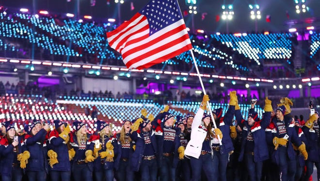 Erin Hamlin leads the delegation from the United States during the opening ceremony for the Pyeongchang 2018 Olympic Winter Games at Pyeongchang Olympic Stadium on July 12.