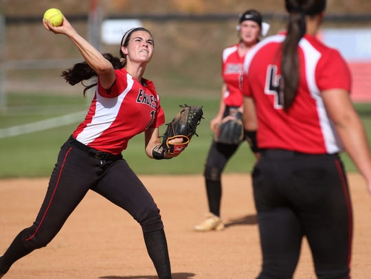 NFC's Alicia Price throws the ball to first base after