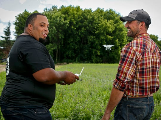 Retired offensive lineman Jason Brown, famous for walking away from a successful professional football career to become a farmer in North Carolina, trains for the Land O'Lakes Farm Bowl with Jacob Carrow from Enchanted Dairy, by learning to fly a drone, which have become staples on modern farms today, on Sunday, July 23, in Little Falls. The Land O'Lakes Farm Bowl presented by GENYOUth will pit teams of current and former professional football players and Land O'Lakes farmers against each other in a series of on-farm experiences and light-hearted farm-themed challenges.