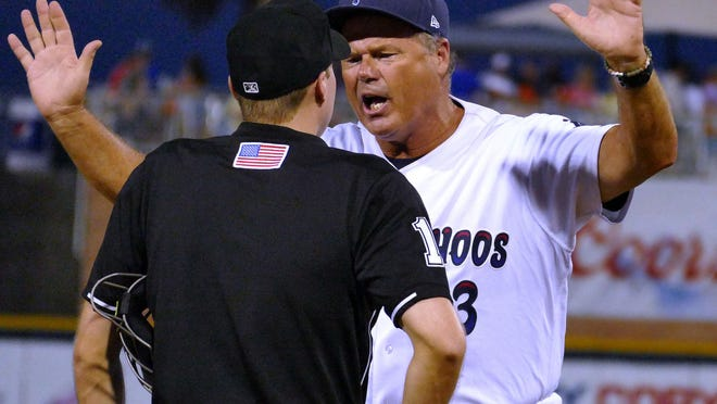 Pensacola Blue Wahoos manager Pat Kelly argues a call with an umpire that went against the Wahoos at third base during their game with the Mobile BayBears on Thursday evening in Pensacola.