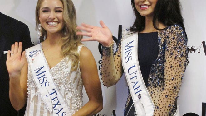 Miss Texas Margana Wood and Miss Utah JessiKate Riley meet the media Wednesday after winning the first night of preliminary competition in the Miss America competition in Atlantic City.