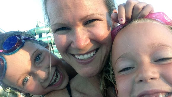 Patty Triplett West does a selfie with her daughters.