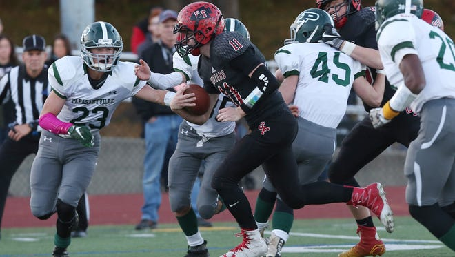 Glens Falls' Joseph Girard (11) finds some running room in the Pleasantville defense during first half action in the the Class B state semifinal football game at Dietz Stadium in Kingston, N.Y. Nov. 19, 2016.