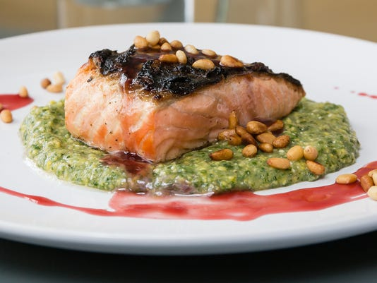 636286384503507880-CWC-Salmon-with-Kale-Polenta-Pomegranate-Reduction-and-Toasted-Pine-Nuts.jpg