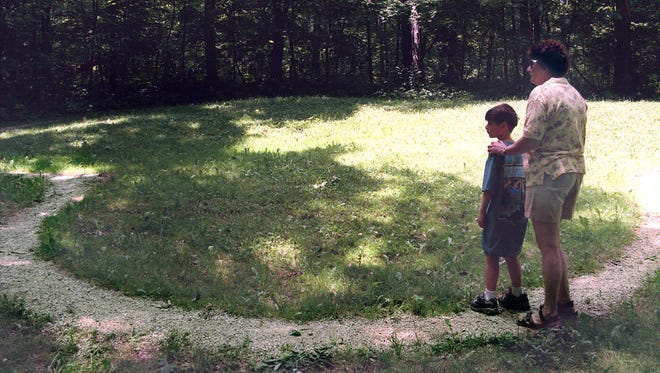 Visitors to Little Bear Effigy Mound at the Effigy Mound National Monument in Marquette.