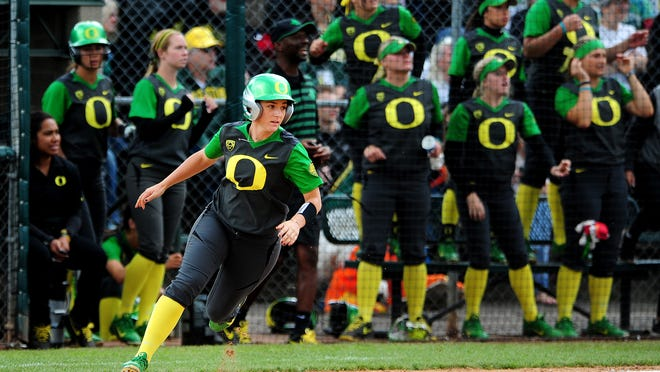 Oregon's Lauren Lindvall rounds first base for a 2 RBI double against North Dakota State during the NCAA regional round at the University of Oregon, on Saturday, May 16, 2015, in Eugene. Oregon won the game 6-1.