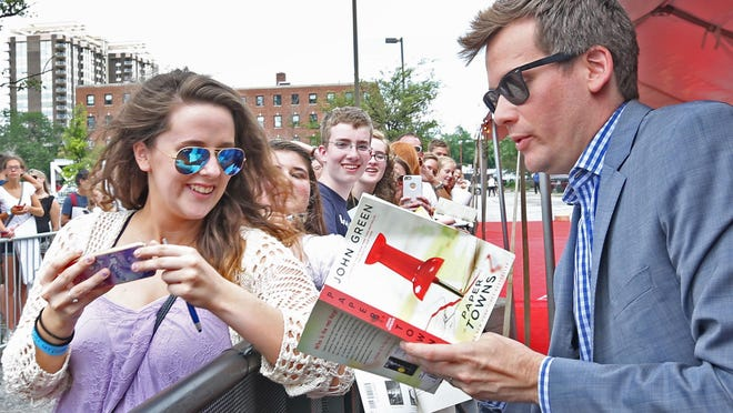"""Kelsey Grimes, from Westfield, left, gets an autograph from """"Paper Towns"""" author John Green by the red carpet during the """"Paper Towns"""" movie tour at Old National Centre, Tuesday, July 14, 2015. The """"Get Lost Get Found"""" tour begins in Indianapolis, hometown of author John Green, and stops at two other sites in the US before opening in theaters July 24."""