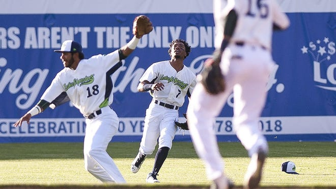 Vermont Lake Monsters left fielder James Terrell, center, calls off a teammate for a fly ball against Brooklyn during Wednesday night's game at Centennial Field.