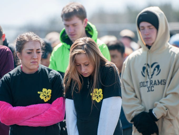 People bow and pray at the 5K for Tay memorial event
