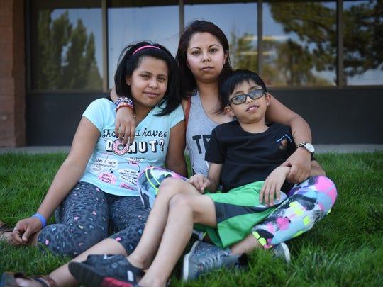 DACA recipient Maria Roberto poses for a portrait with her children, Ashlee Romano, left, and Gerardo Mederos, in Reno on May 27, 2017. Jason Bean/Reno Gazette-Journal- USA TODAY NETWORK