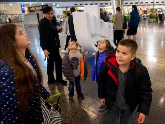 The Cuahua children, from left, Cecily, 10, Enrique, 5, Marrissiah, 6, and Anthony, 8, find the birds flying free inside the terminal of the Indianapolis International Airport entertaining Thursday morning. The children are emigrating to Mexico to be with their father, Antonio Cuahua, who was deported from Owensboro, Kentucky, after an ICE raid in September 2017. Their aunt, Jacqueline Linares took care of the children until their travel plans were finalized. None of the children speak Spanish.