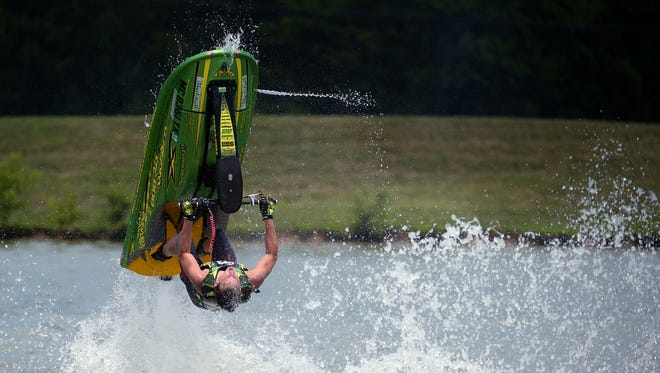 Evan Krefski performs tricks on his jet ski during Franklin's first Freestyle Water Show, which featured three of the nation's top professional jet ski riders. The riders showed off their best tricks in Westhaven's lake Saturday, July 23, 2016.