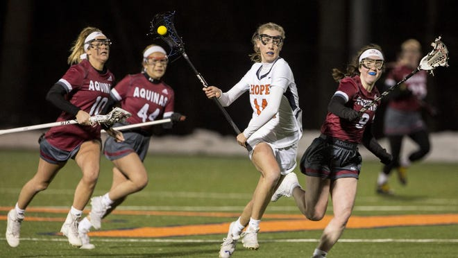 Hope senior Paige Wilmer in a lacrosse game against Aquinas
