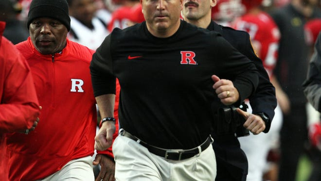 The Rutgers Scarlet Knights take on the Terrapins of the University of Maryland in the season finale of Big Ten football season at High Point Solutions Stadium in Piscataway on Saturday November 28,2015.Rutgers head football coach Kyle Flood runs off the field after his team is defeated by Maryland 41- 46.