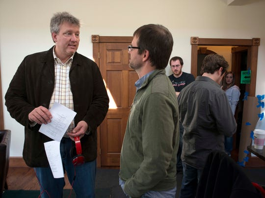 "In this photo provided by Point Park University, producer Chris Moore, left, talks with Point Park University Cinema Arts Associate Professor Nelson Chipman, on the set of Anna Martemucci's film, ""Hollidaysburg,""in Carnegie, Pa. on March 15, 2014."