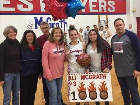 Ali McGrath celebrates with family, former players