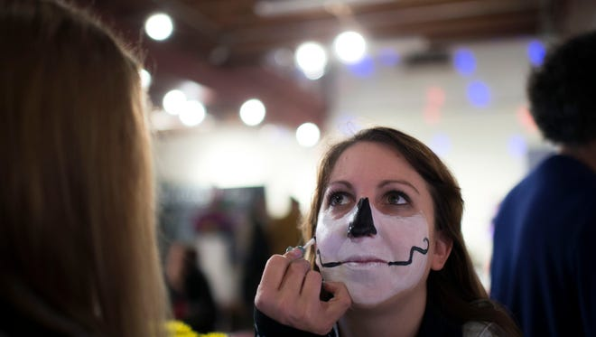 Rebecca Muller has her face painted as #BeforeIDie event ensues at Perkins Center For The Arts Wednesday evening, Oct. 28 in Collingswood.