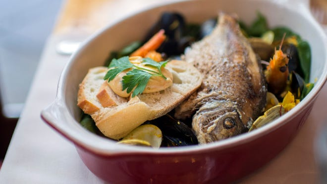 The bouillabaisse will warm you up at Neuf in Philadelphia.