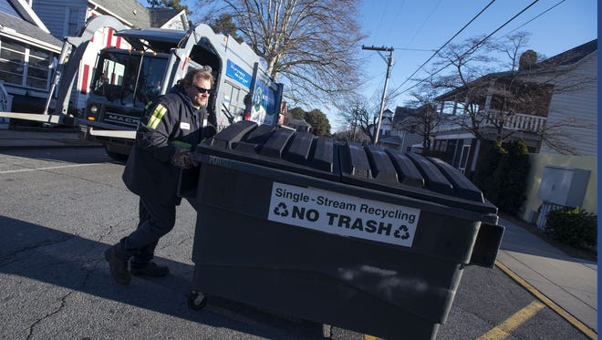 Challenges for Brian Loeb of Waste Industries on a day like Tuesday included trash freezing inside the dumpster and the truck's hydraulics not responding as smoothly.