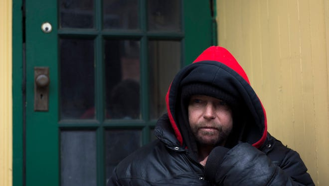 Homeless man Armond Hunt, 54, sits on a stoop on E Commerce St Wednesday, Jan. 27 in Bridgeton.