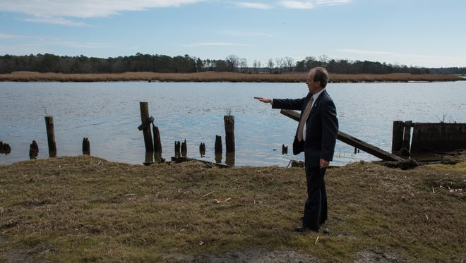 Wicomico County Executive, Bob Culver, stands along the Wicomico river on the Pirate's Wharf property on Monday, Feb. 1, 2016.
