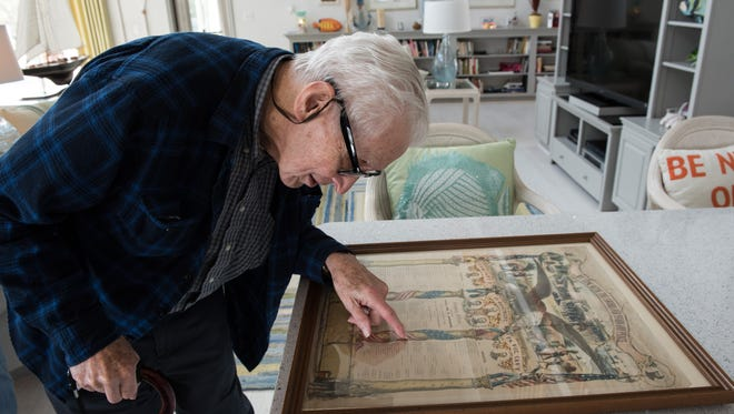 Arthur Campbell, of Ocean Pines, reads from a family artifact at his home on Wednesday, Feb. 10, 2016.